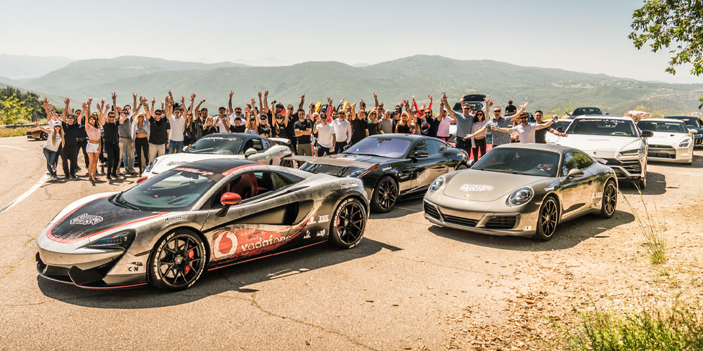 Fast Lane Drive members group photo with cars for Viejas event